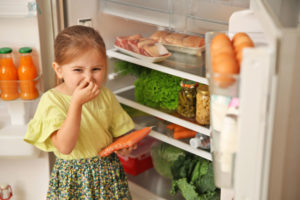 girl with food in refrigerator